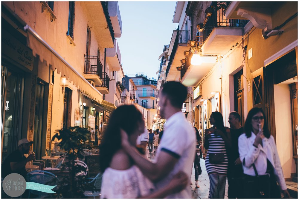 Dom strokes Sabrina's hair during their pre-wedding photo shoot in the streets of Santa Maria di Castellabate.
