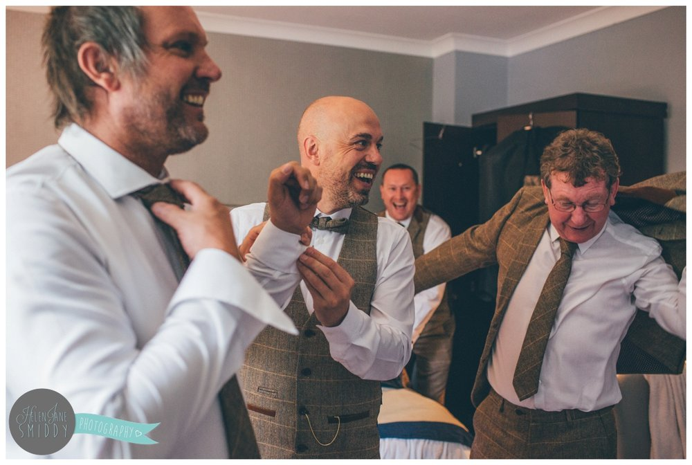The groom and his groomsmen get ready for the wedding at Mottram Hall in Cheshire.