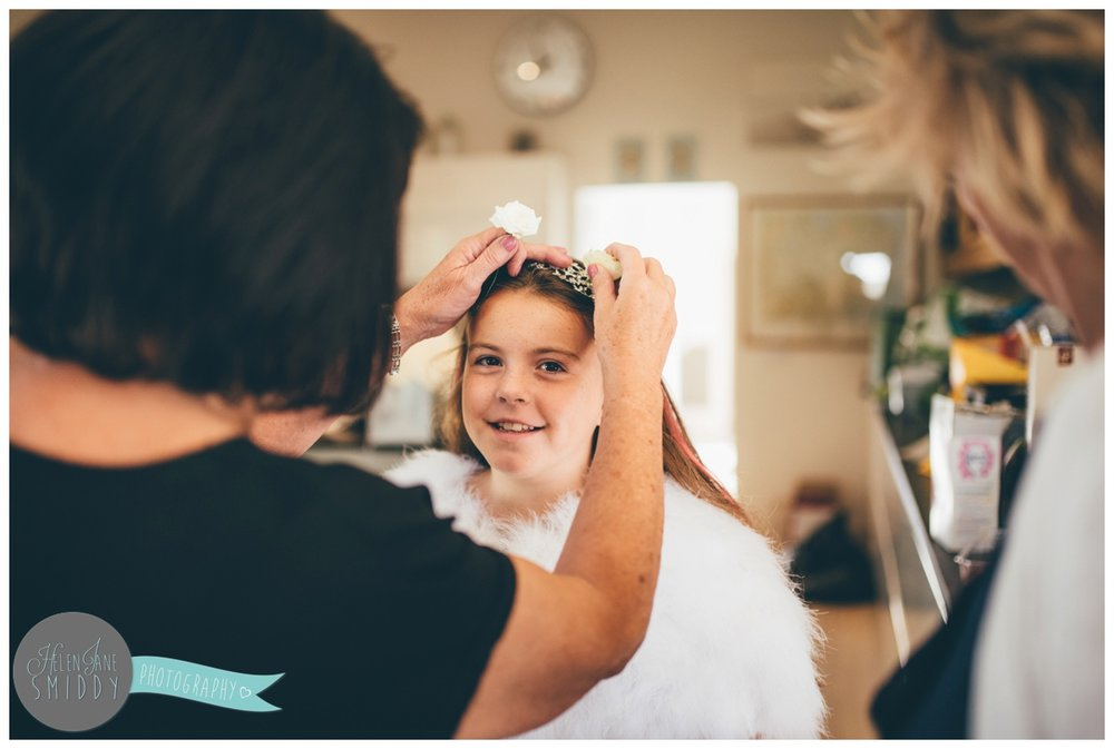 Cheshire wedding photographer captures flower girl getting ready at Barn Drift in Norfolk.