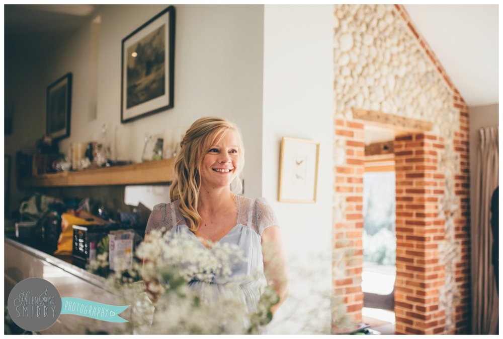 Beautiful, blooming pregnant bridesmaid at Barn Drift in Norfolk.