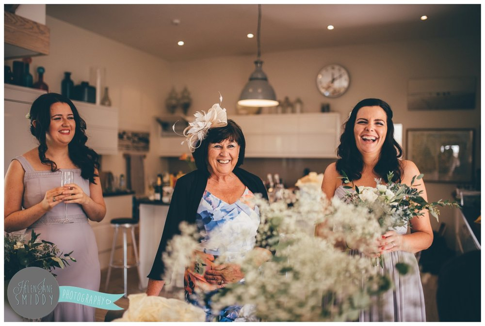 Bridesmaids share a joke on the morning of the Norfolk wedding.