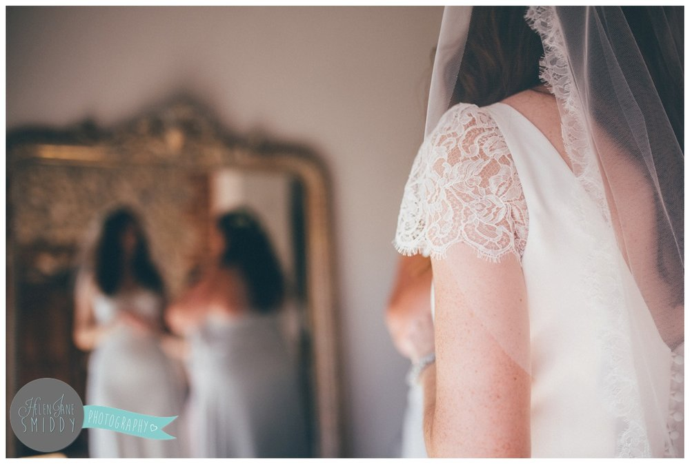 The lace detail of the beautiful wedding gown.