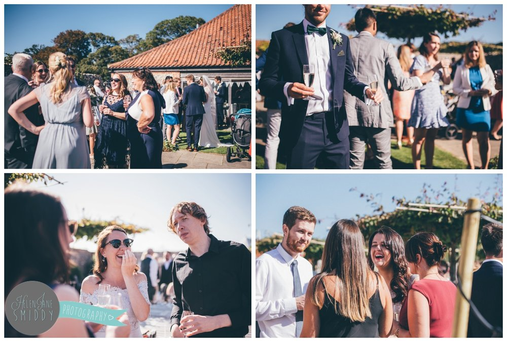 Guests enjoying the sun at a beautiful September wedding at Barn Drift in Norfolk.