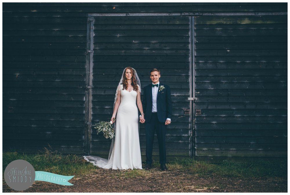 Bride and Groom pose at their beautiful September wedding at Barn Drift in Norfolk.