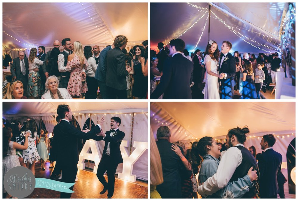 Wedding guests dancing at Barn Drift in Norfolk.