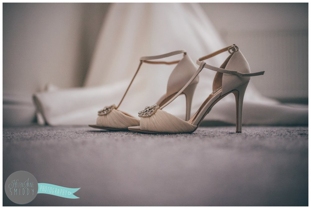 The bride's beautiful wedding shoes.