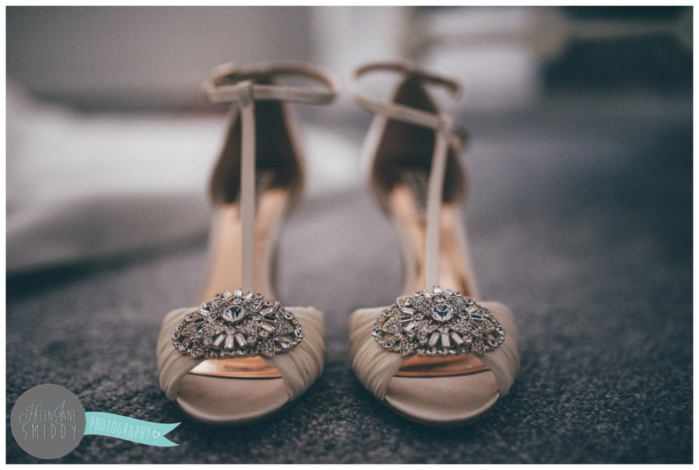 The jewelled detail on the bride's beautiful wedding shoes.