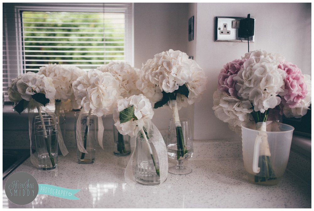 The bride and bridesmaid's wedding hydrangea bouquets in the kitchen, waiting to be used.