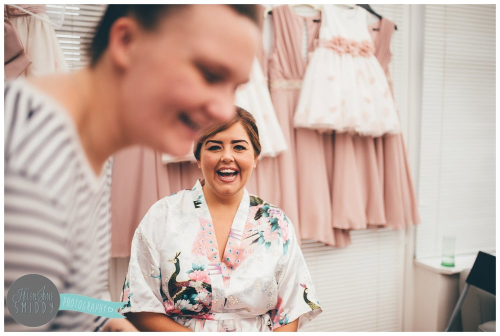 Bride, Hannah, shares a joke with her make-up artist.