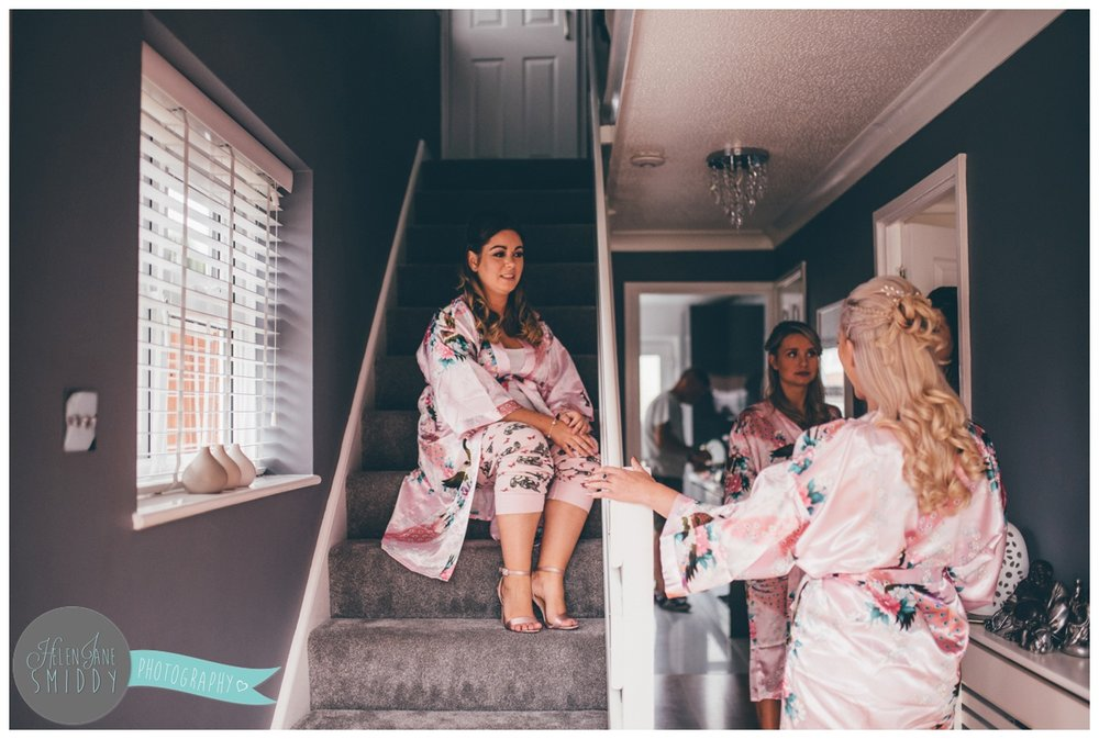 The bridal party gather in their matching dressing gowns.