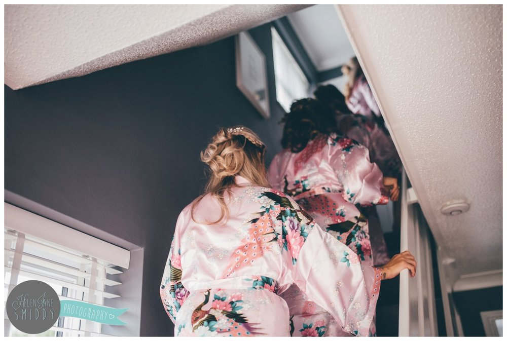 The bridesmaids go upstairs to get ready for the Big Day.