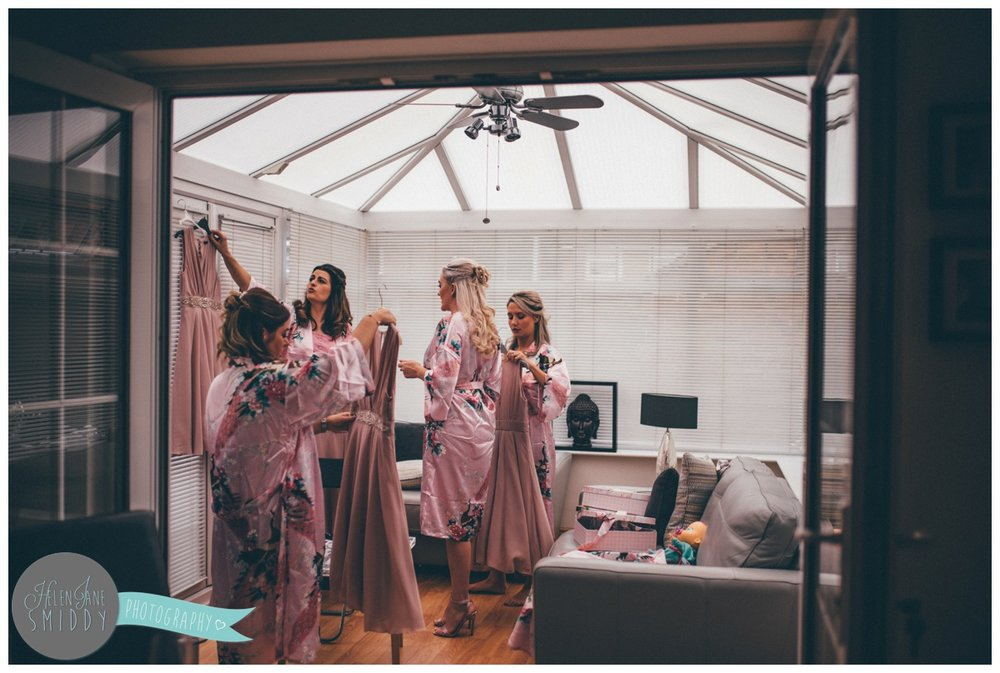 The bridesmaids getting ready for the wedding.