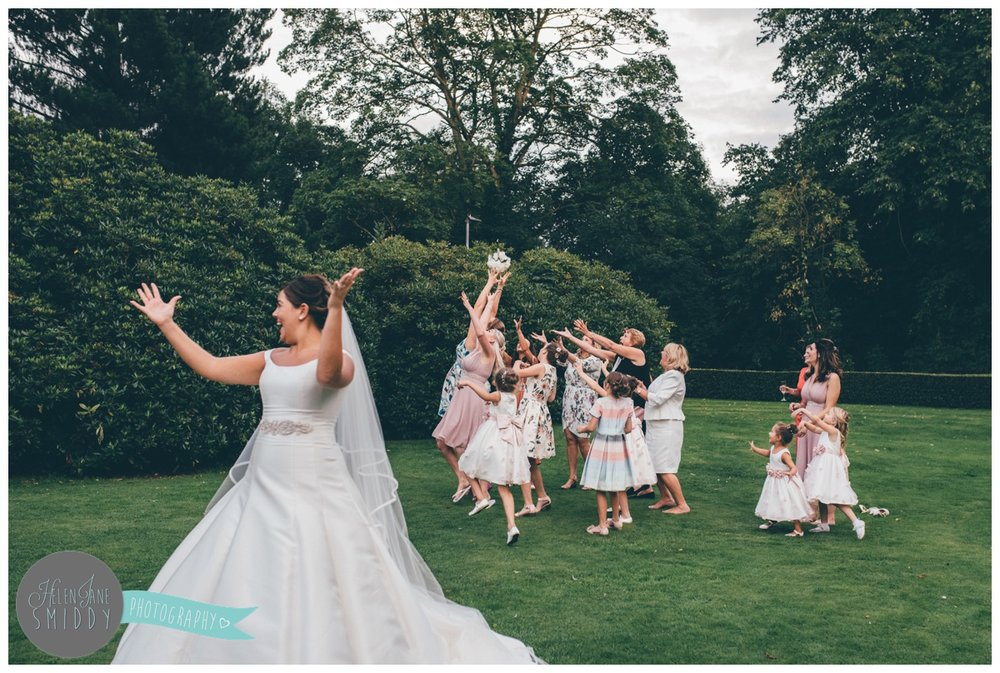The tossing of the bouquet at a Cheshire wedding.