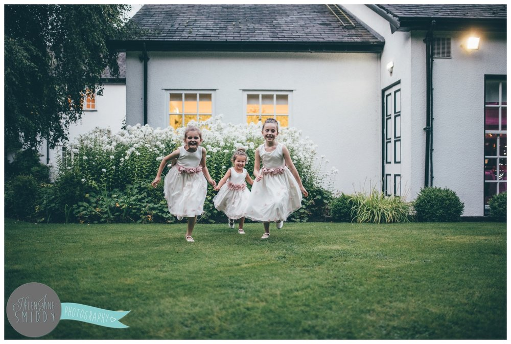 The flower girls have fun at the wedding at Statham Lodge.