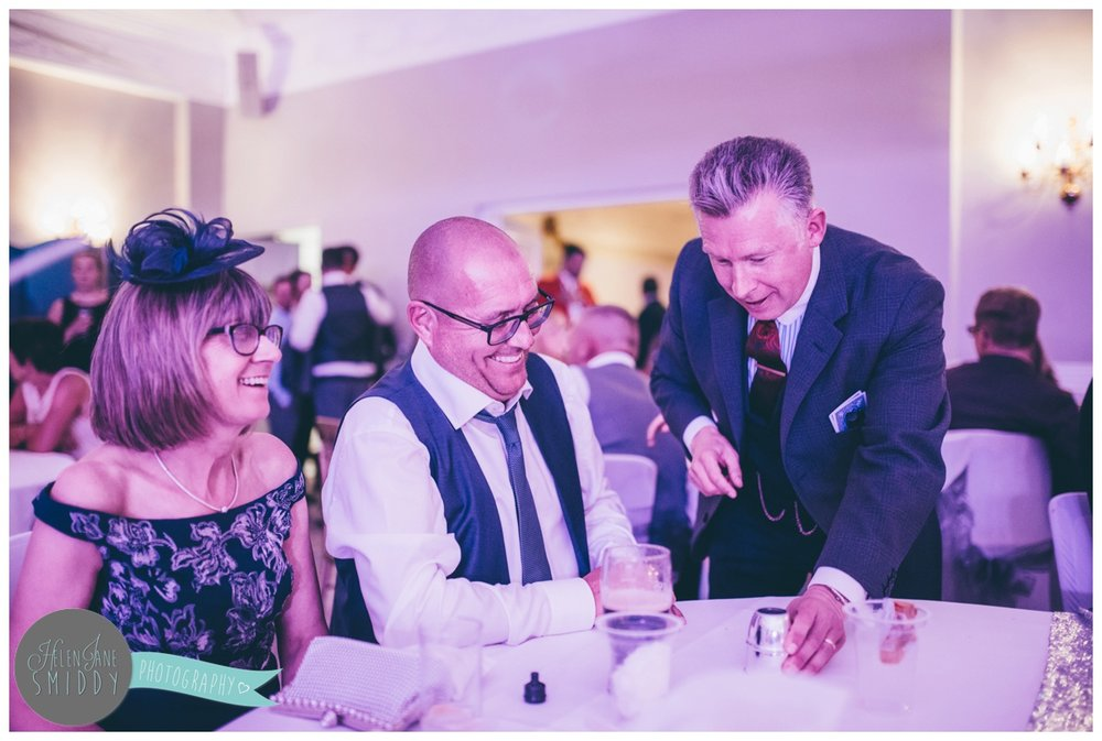 The magician performs for wedding guests at Statham Lodge in Cheshire.