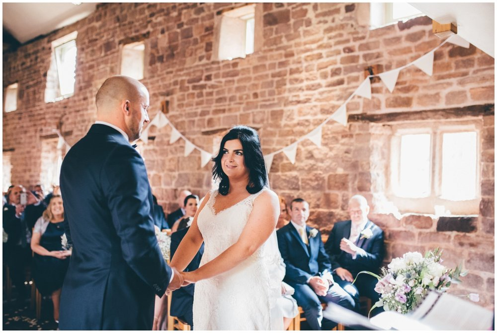 Amy and Phil take their vows  at The Ashes wedding barn in Staffordshire.