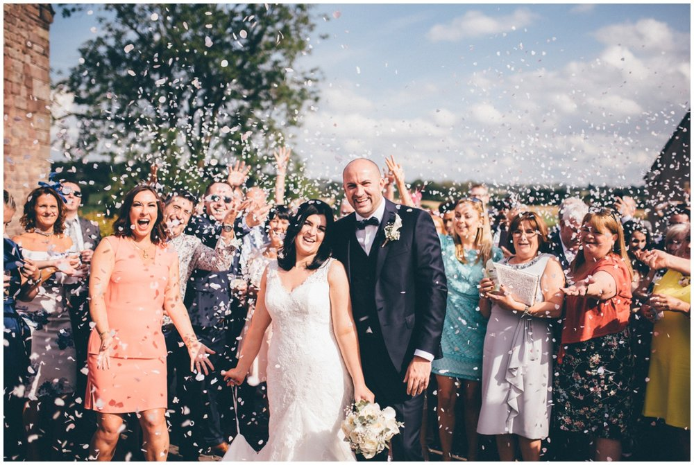 Beautiful sunny confetti photograph at The Ashes wedding barn in Staffordshire.