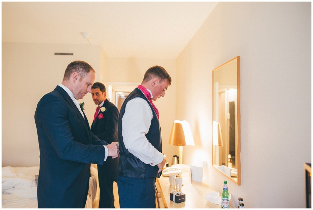 The groom and his ushers get ready on the morning of the Manchester wedding.