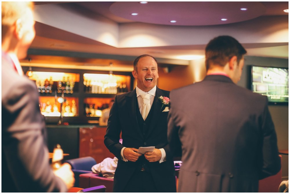 The groom shares a joke with his family and friends before his wedding ceremony in Manchester.