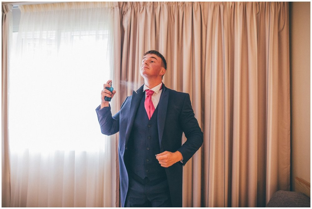 The Best Man sprays his aftershave on the morning of the Manchester wedding.
