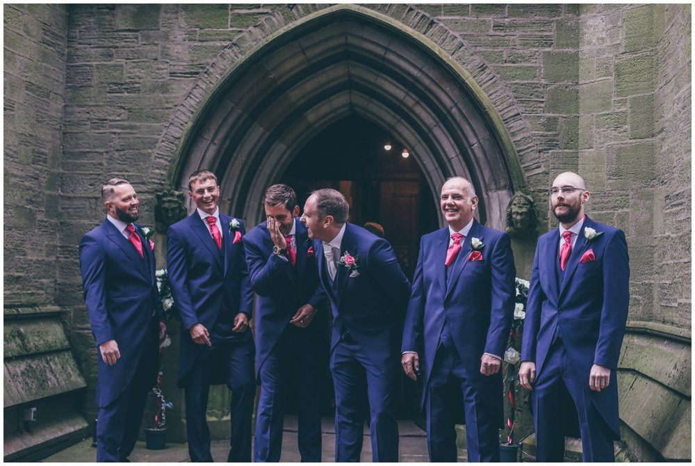 Groomsmen all share a joke outside St Mark's Church in Worsley.