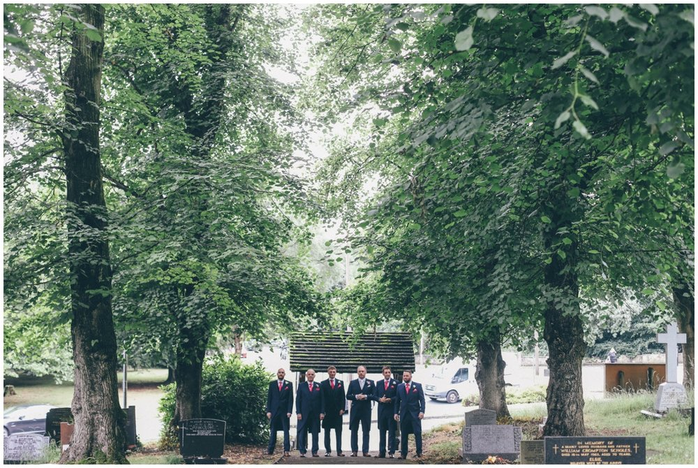 Groomsmen walking into St Marks Church in Worsley.