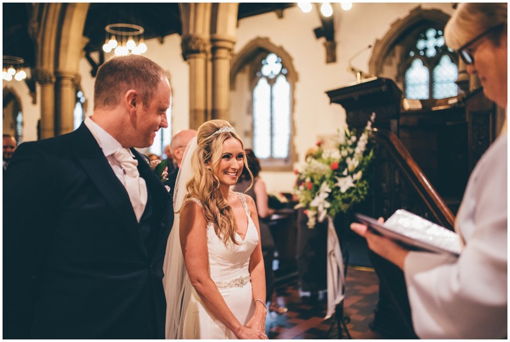 The bride and groom see each other for the first time at St Mark's Church in Worsley.