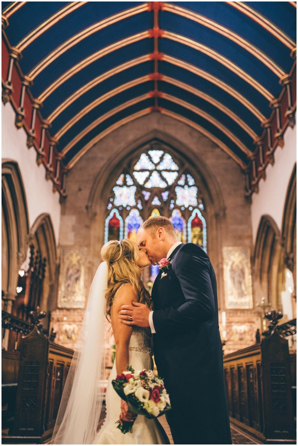 New husband and wife share their First Kiss at St Mark's Church in Worsley.
