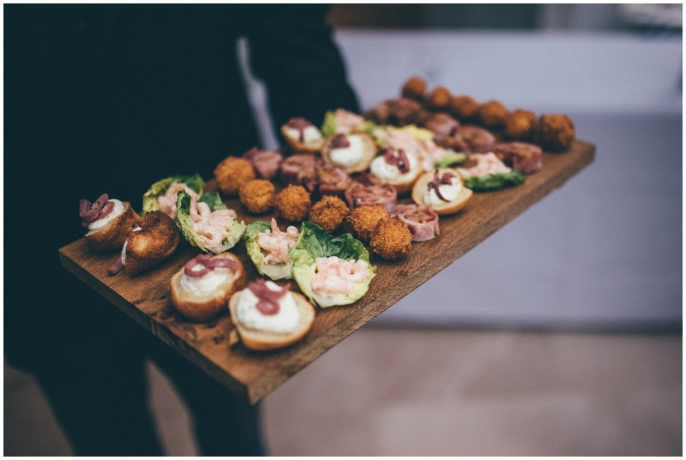 Delicious platter of food being handed around at the wedding reception at Willington Hall.