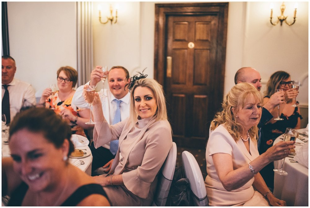 Guests say 'cheers' during the speeches at Willington Hall in Tarporley, Cheshire.