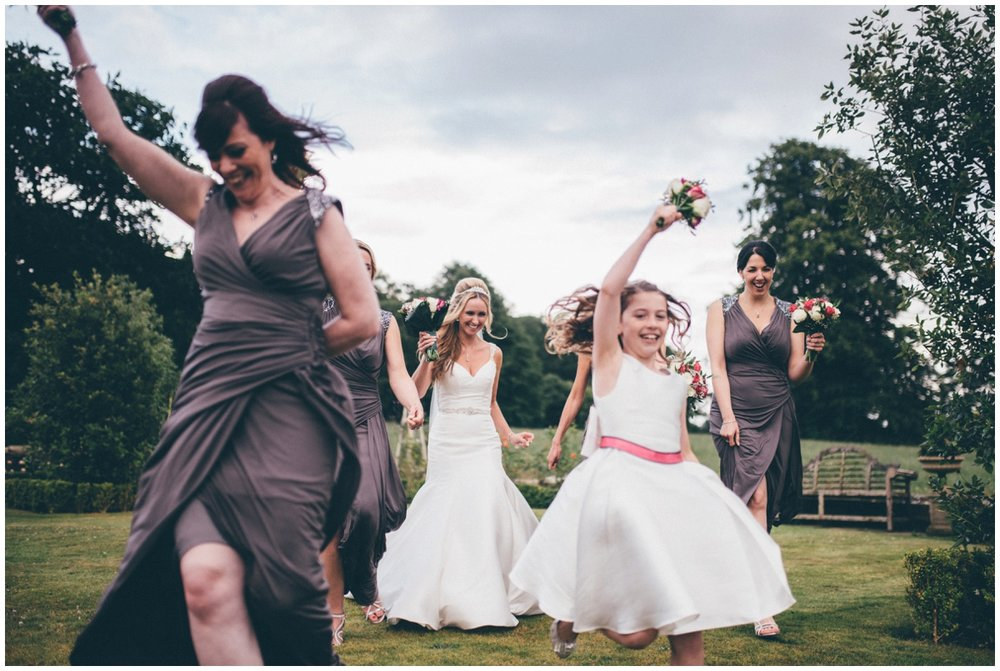 The bride has fun with her bridesmaids during her wedding at Willington Hall.