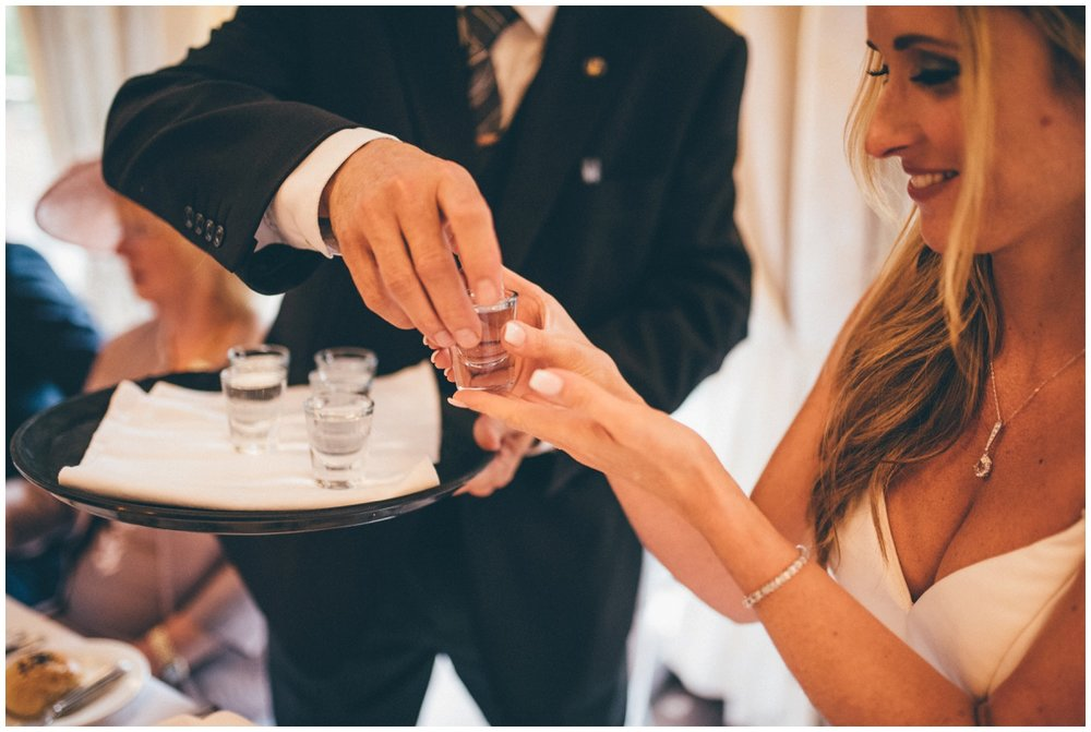 Bride takes a shot of Sambuca in her evening reception at her wedding.