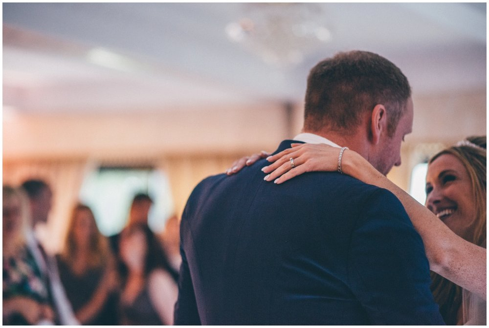 Detailed photograph of the bride and groom during their First Dance at their Cheshire wedding.