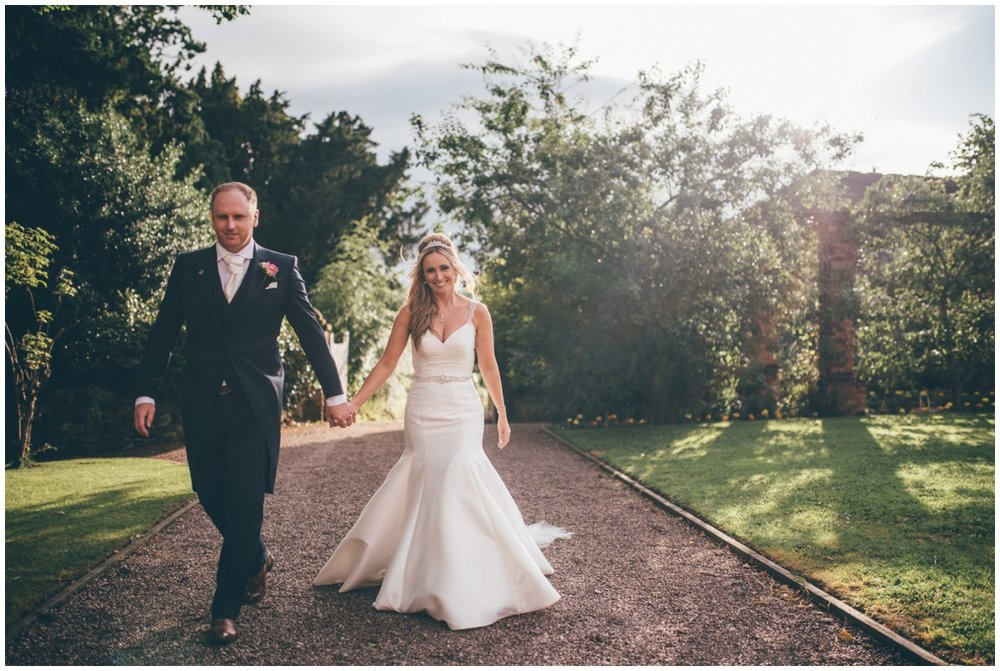 The newlyweds walk through the beautiful grounds of Willington Hall.