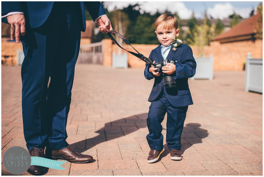 Cute little pageboy at Bassmead Manor Barns.