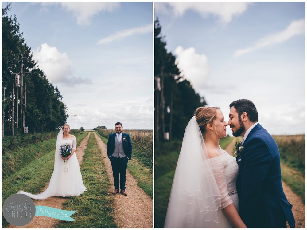 Bassmead Manor wedding barns make for beautiful wedding photographs with their green backdrop.