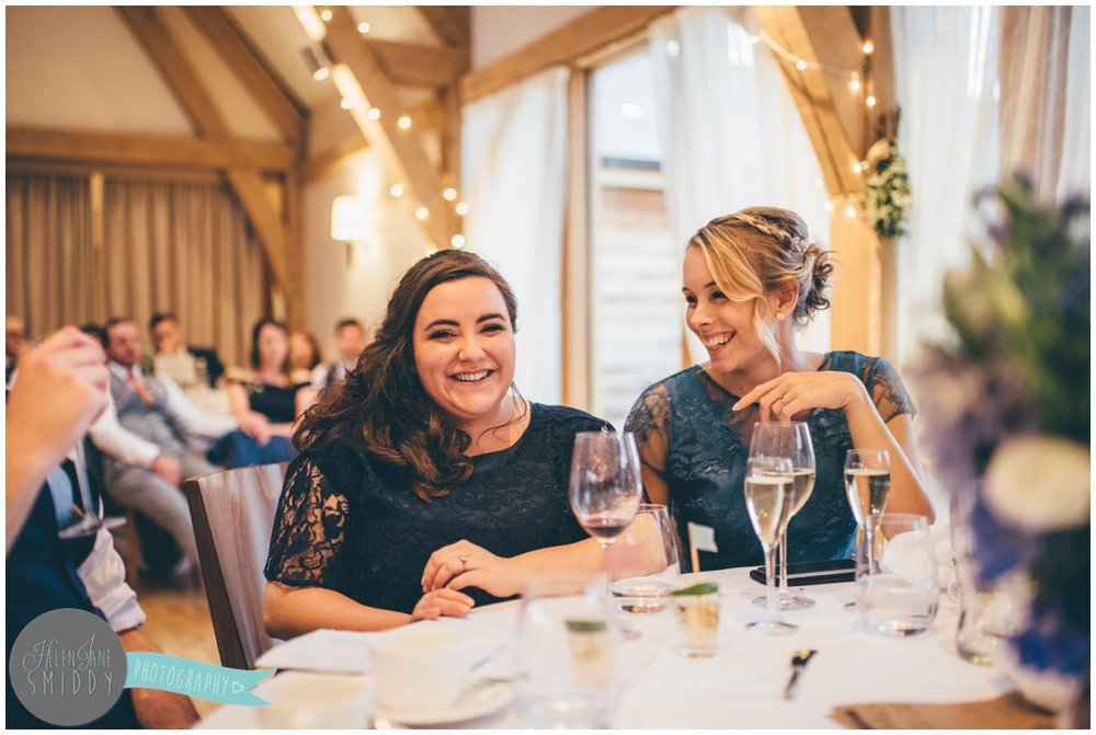 Guests listen to the Wedding speeches at Bassmead Manor wedding barns.