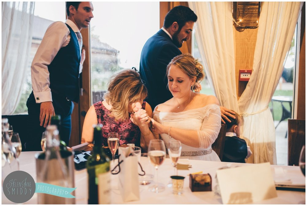 Bride and her mum share an intimate moment during Wedding speeches at Bassmead Manor wedding barns.