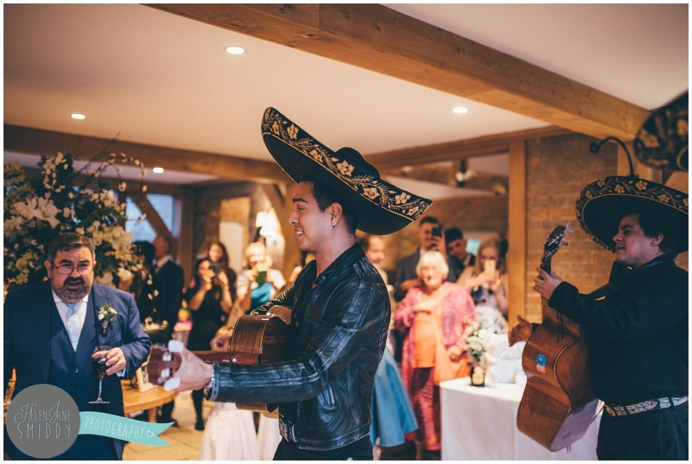 Guests love the Mariachi band surprise at the wedding reception.