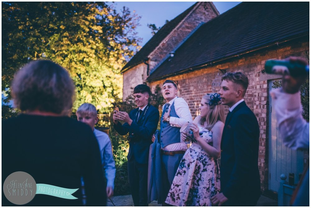 Wedding guests dance and sing along with the Mariachi band at Bassmead Manor barns wedding.