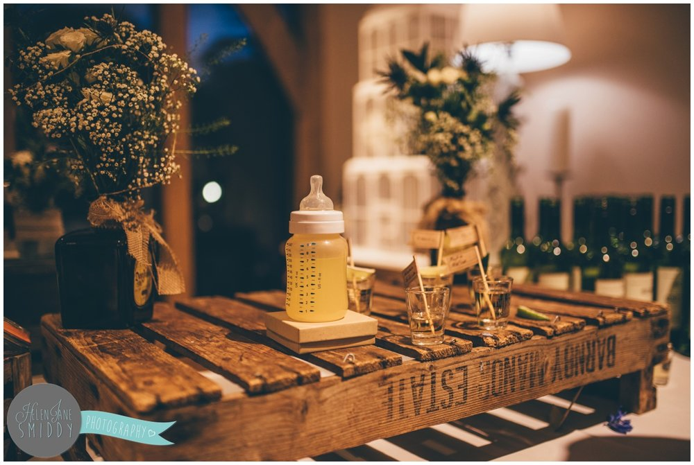 Shots of tequila alongside a baby bottle of milk makes for a funny wedding moment.