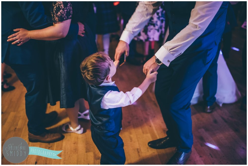 Cute little pageboy dances with his Dad at Bassmead Manor Barns wedding.