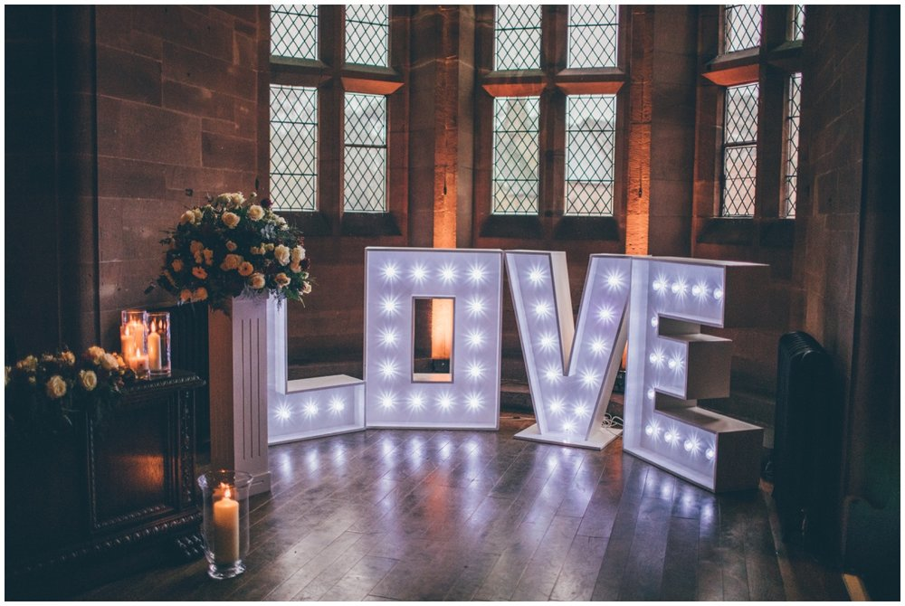 Bang on trend LOVE lights at Peckforton Castle wedding.
