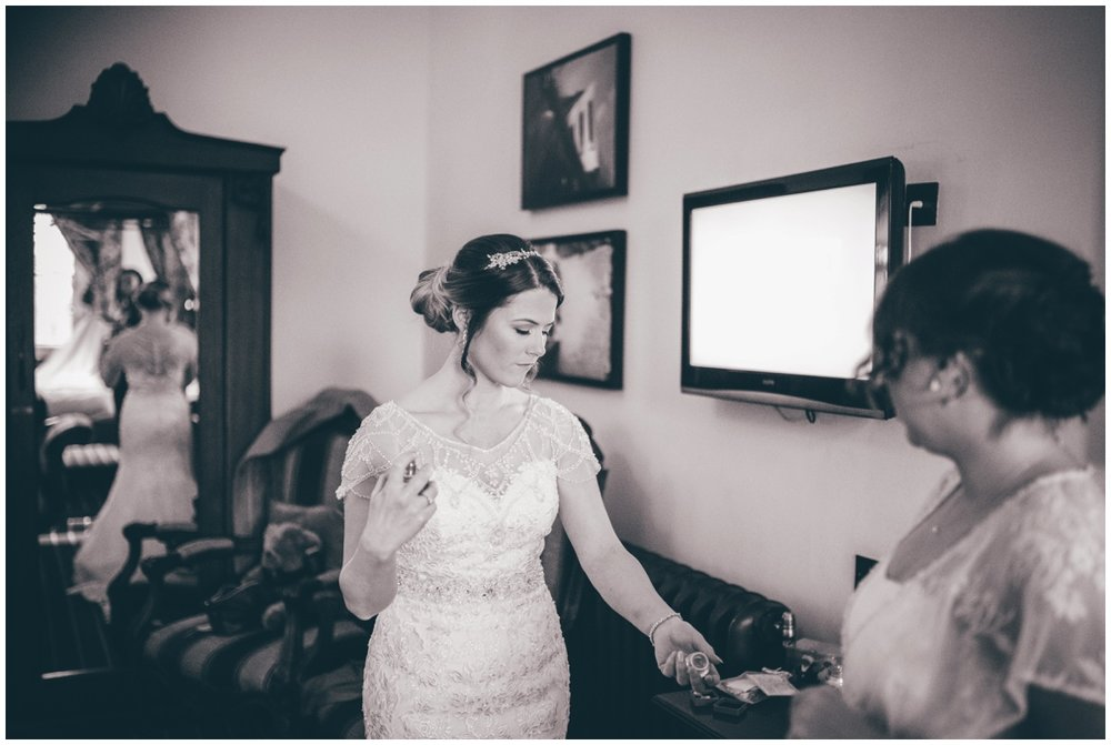 Beautiful bride sprays her perfume whilst getting ready.
