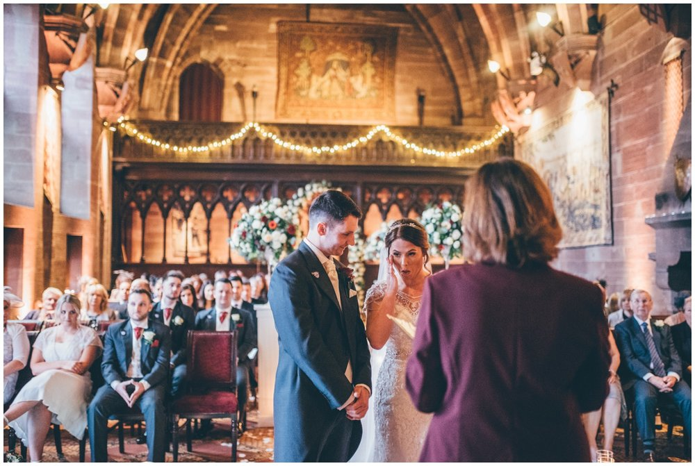 Bride gets emotional during the wedding ceremony at Peckforton Castle.