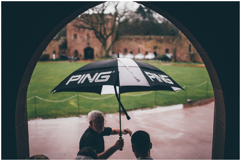 The rain wouldn't stop the newlyweds at Peckforton Castle.