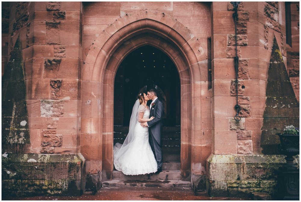 Beautiful and simple wedding photograph at Peckforton Castle entrance.