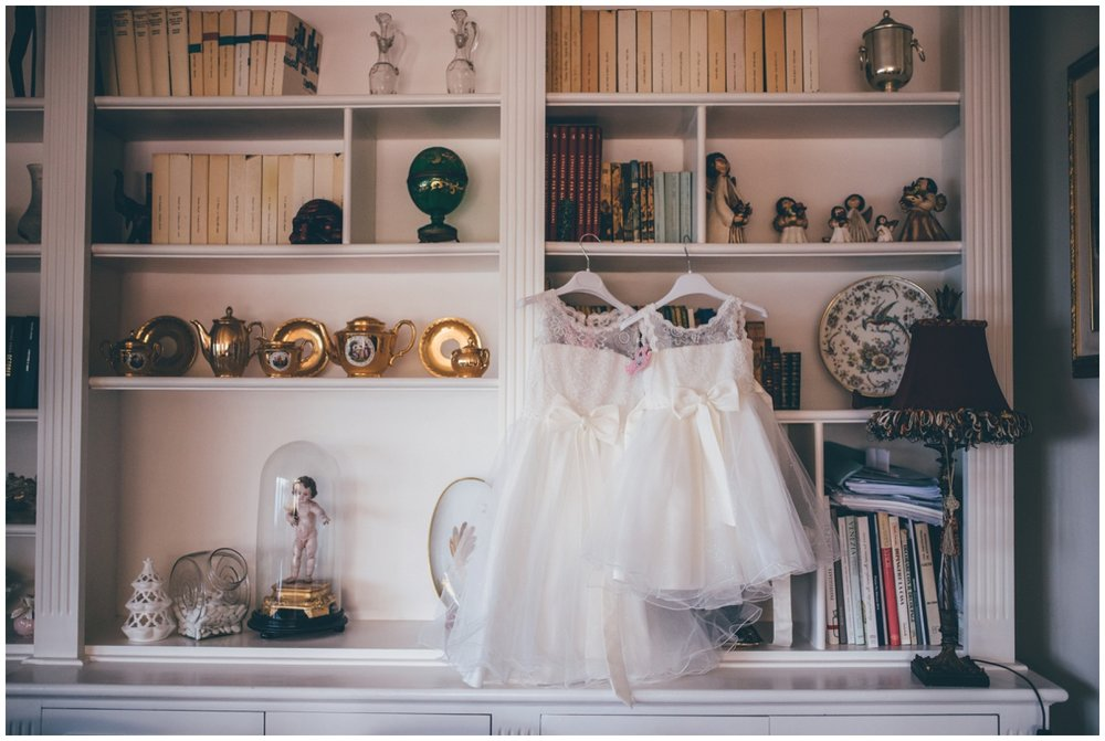 Flowergirl dresses hung up before the beautiful Italian destination wedding.