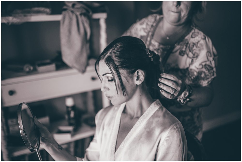 Italian bride getting her hair done on her wedding morning.