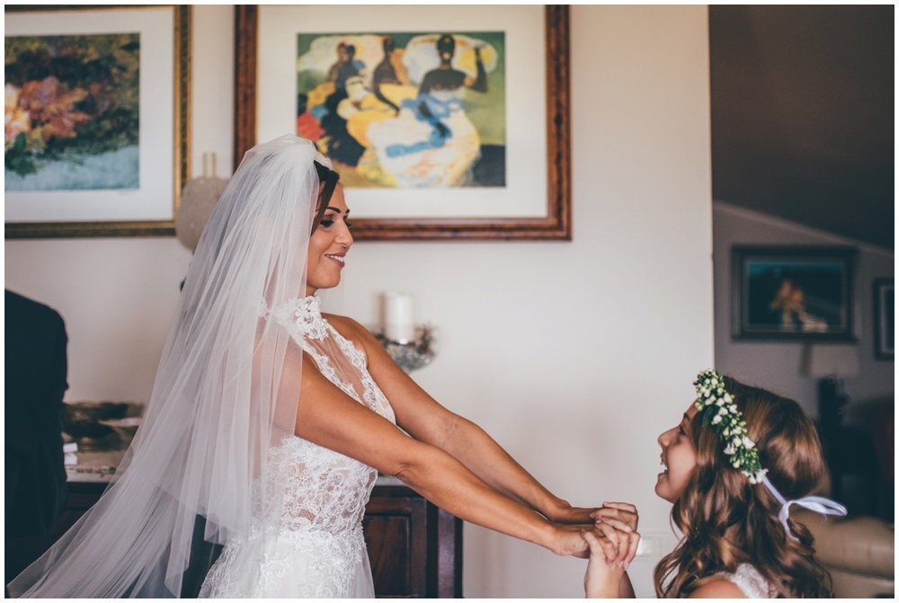 Stunning bride plays with her flowergirl.